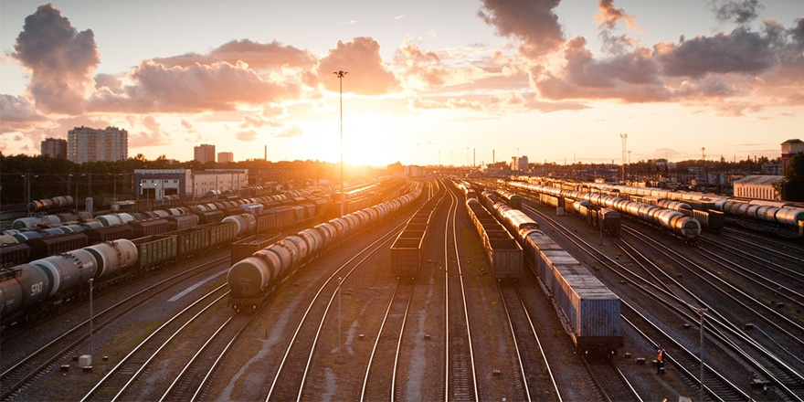 Shipping railroad tracks with multiple trains during sunset to represent hijacked shipping accounts